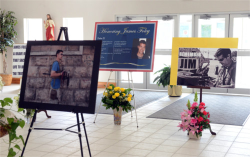 Photos displayed in remembrance of James Foley at a memorial service in August 2014 in Rochester, New Hampshire. Photo: McCollester/Getty Images